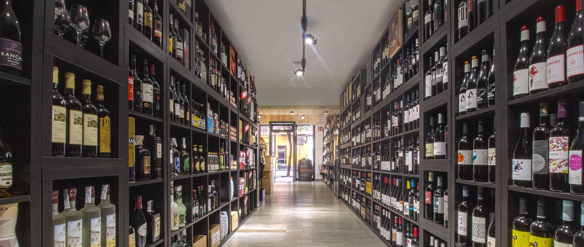 Diseño y ejecución de obra de local comercial Vinyes realizado por Dromstudio